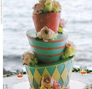 """Guests could not stop staring at the three-layer topsy-turvy cake. It was a piece of art, and it tasted amazing!"" Trista says."