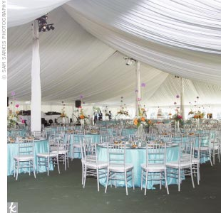 Glenda and Kahn's reception was held beneath a large tent complete with romantic lighting and Caribbean-hued linens.