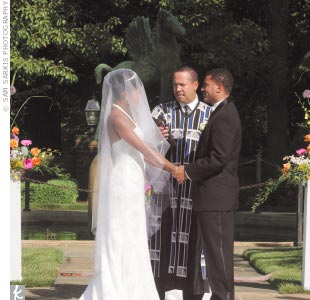 The couple married in the Pegasus Garden at Meadow Brook Hall, located on the grounds of Oakland University.