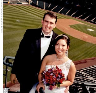In honor of their first date, the couple wed in a Buddhist ceremony on Safeco Field and held the reception in the club's Hit It Here Café. The groomsmen took the field from the home team dugout and lined up on the first baseline, the bridal party from the visitors dugout, lining up on the third baseline. Immediate family sat in the warning track, a ...
