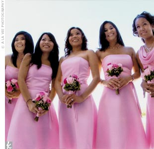 Aimee's six bridesmaids wore two styles of pink tea-length dresses by Jessica McClintock.
