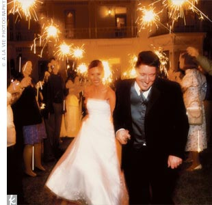 As guests held sparklers aloft, Aimee and Chris made their grand exit and hopped into a waiting limo.