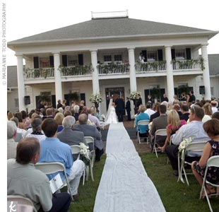 Amberley and Doug exchanged vows in front of the bride's family's home, a large, antebellum-style house.
