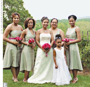 The three bridesmaids and maid of honor chose their own styles of dresses from Jenny Yoo. Each dress was knee-length and made of silvery silk shantung, and the three maids&#39; dresses also included a contrasting raspberry pink sash.
