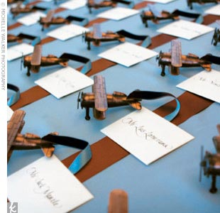 After hours searching online, the couple found the perfect thematic favors -- copper-finish pencil sharpeners in the form of vintage biplanes. They were attached with ribbons to the escort cards, and arranged on the table to look as if they had just landed.