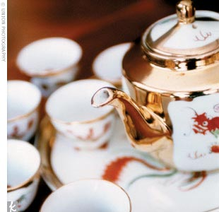 """Jennifer and Alfred presided over a tea ceremony, a tradition in which the newlyweds serve tea to their parents and older relatives as a sign of respect while receiving well wishes and words of advice -- plus red envelopes filled with """"lucky money"""" --from their elders. Meanwhile, wedding guests sipped tea and ate finger foods at a tea reception."""
