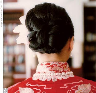 An orchid adorned Jennifer's elaborate updo throughout the festivities.