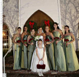 For their early-December wedding, Holly and Trey chose a holiday theme with a modern twist, using sage green with cranberry red accents for the flowers, bridesmaid dresses, decorations, and invitations. Candles created a soft, warm glow in the cold winter night, and the ceremony and reception spaces were adorned with handmade pearl wreaths and a re ...