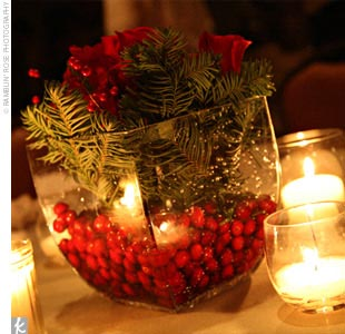 Winter-themed floral arrangements helped Holly and Trey's Christmastime wedding glow with rich color. At the bridesmaid luncheon the day before the wedding, attendants and family all pitched in to make the bouquets and centerpieces, using roses, berries, holly, and winter greenery. White snapdragons (a favorite of the bride) were also incorporated  ...