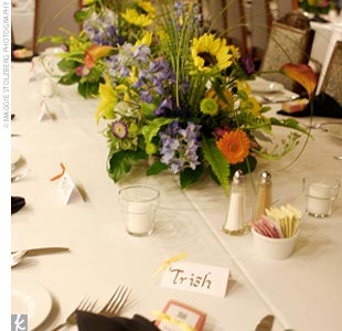 Bright, multi-colored arrangements topped off the tables.