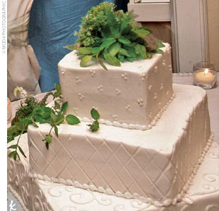 "Amy and Josh's ""simple and tasty"" three-tiered square cake was decorated with fresh flowers."