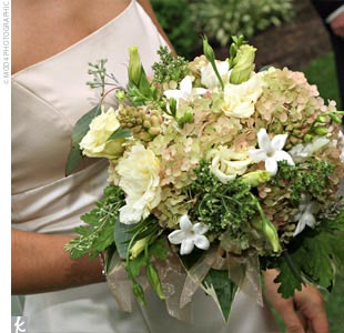 Organic elements, including herbs and eucalyptus, were combined with hydrangeas, tuberoses, dahlias, lisianthus, and freesia in shades of green, ivory, and soft shades of pink, creating a fresh, garden-like look in Amy's bouquet.