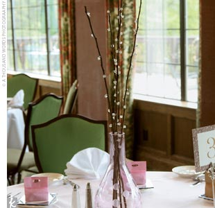 Each of the reception tables at Katie and John's wedding was decorated in chocolate brown and light pink, with alternating centerpieces of pink roses and pussy willow.