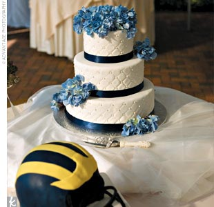 Sandy and Kyle's elegant three-tier cake decorated with fresh blue hydrangeas was accompanied by a German chocolate groom's cake in the shape of a University of Michigan football helmet.