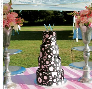 """The cake was amazing,"" Ryan says. The creative confection had four tiers decorated with pink fondant and various-sized black fondant circles. Each layer was a different flavor: tiramisu cheesecake, German chocolate mousse, cream cheese–filled carrot cake, and red velvet."