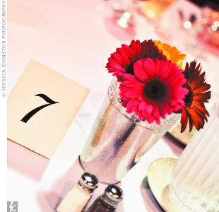 Aly and Nik chose to accent the guest tables simply with galvanized tin vases of gerbera daisies.