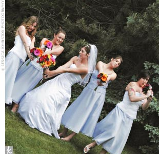 Aly chose the color (periwinkle) and then let her bridesmaids choose their own skirts and tops from David's Bridal.