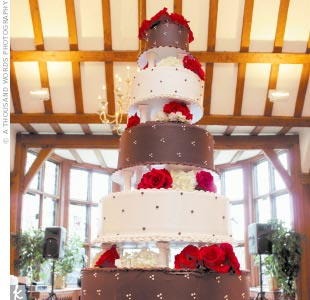 "The five-tier cake was a dream come true for Jennifer. Iced in dark chocolate ganache and ivory butter cream, the towering dessert ""was beautiful and delicious!"" she says."