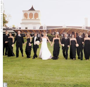 The seven bridesmaids were stylish in black strapless dropped-waist dresses with tiered ruffles.