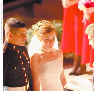 Nick, handsome in his dress blues, waited for Stephanie at the altar of the church where she had been baptized. The two exchanged traditional vows, with Stephanie in a strapless silk satin gown.