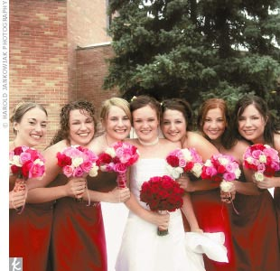 Stephanie was surrounded by five bridesmaids in red satin dresses.