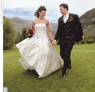 Staci wore a strapless off-white silk A-line gown by Matthew Christopher.