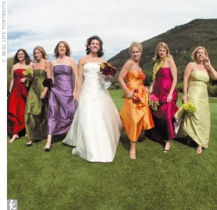 Staci's seven bridesmaids each wore handmade dupioni silk dresses in different jewel tones.
