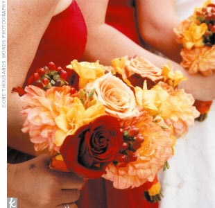 """The flowers that I chose for the wedding were comprised mostly of dahlias (they are one of my favorite flowers), freesia for fragrance (one of my mother's favorite flowers), roses, and hypericum berries,"" Amanda says."