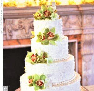 Mimi and Greg's wedding cake came in two tempting flavors, chocolate with chocolate mousse, and yellow cake with rum filling. The outside of it was adorned with green and red cymbidium orchids.