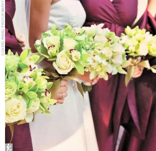 Mimi's bridesmaids held orchid-filled bouquets, which lent an exotic flair to the otherwise classic event. The bouquets coordinated nicely with the deep red bridesmaid dresses.