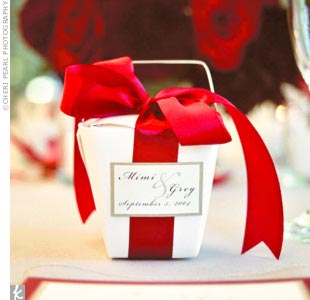 Guests left the reception with chocolate-covered fortune cookies in tiny Chinese take-out boxes. Each box was tied off with a deep red ribbon.