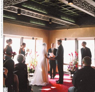 "Lara and Mike's ceremony, held at the Chinese Room at Smith Tower, boasted a birds-eye view of the ""Emerald City"" from the wraparound balcony. ""It was one of those picture perfect, clear, blue sky, fall days,"" the bride remembers."