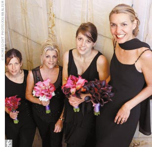 "Lara's four sisters and sisters-in-law were her bridesmaids. Lara asked them to wear any style dress they wanted, as long as it was in black. ""We wanted everyone to be comfortable,"" Lara says, ""and not have to make room in their closets for another bridesmaid dress."""