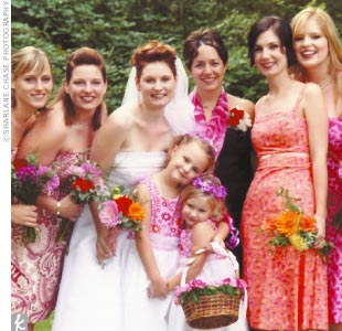 Deborah had five bridesmaids. She picked out fabulous bright-colored pink and purple fabric from a neighborhood store and the maids made themselves knee-length, sundresses.