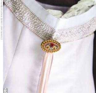 Deborah's paternal grandmother was unable to attend the wedding. In honor of her grandmother, Deborah wore one of her brooches clipped on to the back of her gown