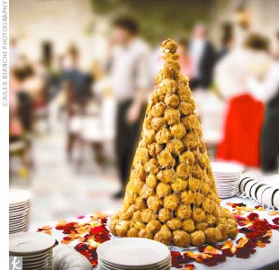 Toward the end of the reception, guests enjoyed Mexican spiced coffee and croquembouche -- a traditional French wedding cake made of cream puffs and caramelized sugar -- from La Conversation, the West Hollywood cafe where John dines daily.