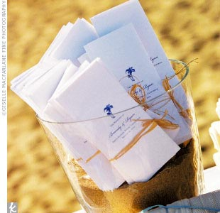 Light blue and crisp white programs were uniquely displayed in tall sand-filled cylinders.