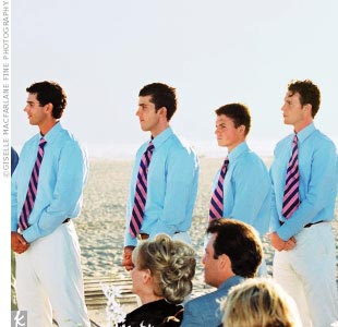 The groomsmen completed the beach theme by donning beige suit pants, light blue oxfords, and pink-and-blue striped ties from Banana Republic.
