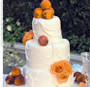 "Brandy and Ryan chose a three-tiered yellow butter cake with mango/peach mousse and Bavarian cream. ""It was so delicious and beautiful,"" Brandy says of the cake, which was decorated with fresh peaches and fresh peach roses."
