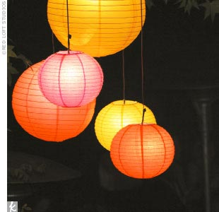 Asian decor elements, like illuminated red, pink, and orange Chinese lanterns, added a splash of color to the night sky.