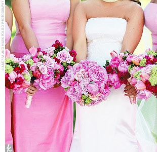 The bridesmaids' peppy, preppy hues were set off by the brilliant bouquets -- pink peonies, ranunculuses, and roses for the bride and even bolder arrangements of parrot tulips, hydrangeas, peonies, and roses for the maids.