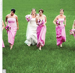 Lee's bridesmaid dresses were designed to echo her gown's delicate details, including the ribbon-wrapped waist. The two-piece, peony pink ensembles featured an organza overlay on top and a floor-length silk dupioni skirt.
