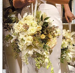 Tiffany's white-clad bridesmaids carried a medley of flowers created in an oasis cage and hung from an ivory ribbon.
