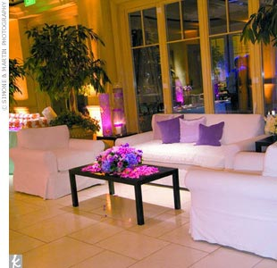 For the cocktail hour, the Montage Resort & Spa's foyer was transformed into a chic lounge with oversized white couches and purple accents.