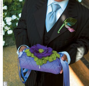 Alicia's nephew carried a quilted purple silk pillow tied with purple ribbon and topped with green and purple blooms.