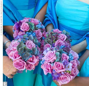 The oceanside wedding inspired Alicia's vibrant deep blue and violet bridesmaid bouquets. The couple's initials were tied with ribbon at the stem of each bouquet.  Florist- Mark's Garden, Los Angeles