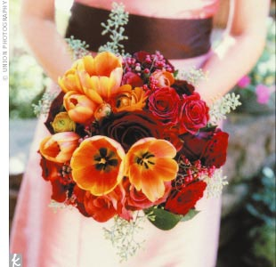Katie fell in love with the Leonidas rose and used it throughout the big day. The bridesmaid bouquets were filled with tulips, Leonidas roses, Black Magic roses, foliage, and berries.