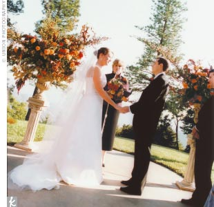 """The ceremony took place on a slope overlooking Napa Valley under a natural canopy of pine trees. Katie's stepfather and stepmother officiated, performing a nondenominational ceremony that reflected the couple's personalities. """"It was important for us to have our community feel involved,"""" Katie says. After the couple read a personal statement of int ..."""