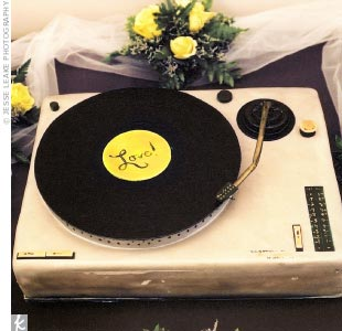 The groom's cake, chocolate cake with raspberry filling, was made in the shape of a turntable.