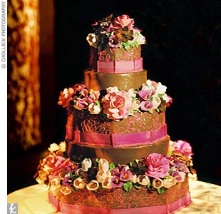 Alternating round- and hexagon-shape tiers were covered in pink and chocolate brown icing. The stylish confection was filled with lemon, strawberry, hazelnut, and apricot flavors.